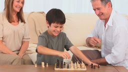A game of chess between a grandfather and his gran Footage