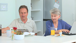 Mature couple taking a breakfast Footage