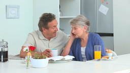 Retired couple taking a phone call Stock Video Footage