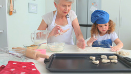 Grandmother and her grand daughter baking together Footage