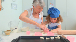 Girl baking with her grandmother Stock Video Footage