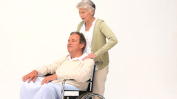 A man in a wheelchair having a massage of his wife Footage