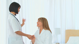 A patient talking to her nurse Footage