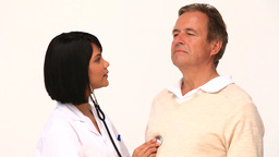 Asian nurse using a stethoscope on her patient Footage