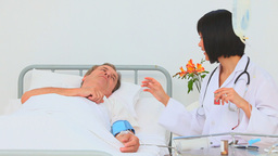 Asian nurse taking the blood pressure of her patie Footage