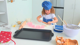 Cute little girl baking alone Footage