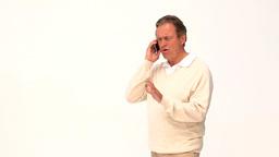 Casual elderly man speaking on the phone Footage