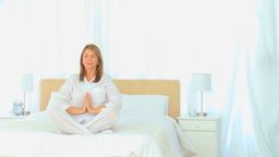 Mature woman doing yogo Stock Video Footage