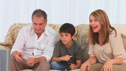 Family watching a match on tv Stock Video Footage
