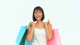Happy asian woman with shopping bags Footage