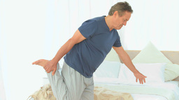 Retired male stretching himself Footage