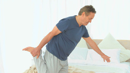 Retired male stretching himself Stock Video Footage