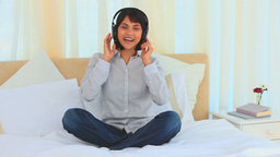 Cute asian girl listening to music Stock Video Footage
