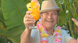 Aged man with a cocktail Footage