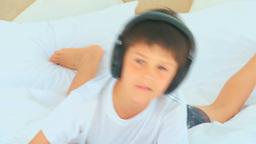 Little boy listening music Footage