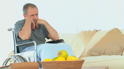 Sad man in a wheelchair thinking Footage