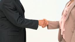 Two business people shaking hands Footage