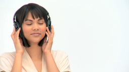 Lovely asian woman listening to music Stock Video Footage
