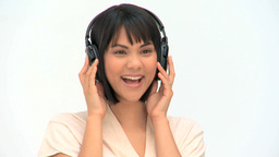 Lovely asian woman listening to music Footage
