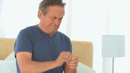 A sick man taking his pills Footage