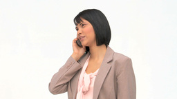 Asian woman speaking on the phone Stock Video Footage