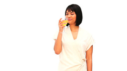 A pretty asian woman enjoying a glass of white win Footage