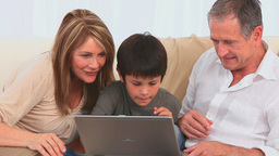 Family playing a game on the laptop Stock Video Footage
