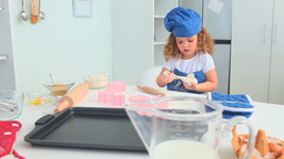 Little girl with an hat baking Stock Video Footage