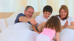 Children waking their grandparents up Stock Video Footage