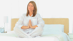 Mature woman doing yoga Stock Video Footage