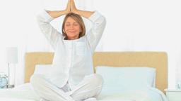 Mature woman doing yoga Footage