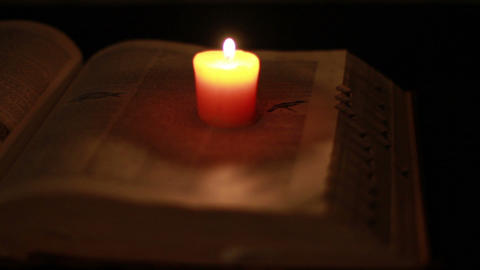0368 Ancient Giant Book with Candle Light Stock Video Footage