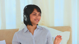 Asian woman listening to music Footage