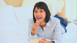 Chinese woman eating popcorn Stock Video Footage
