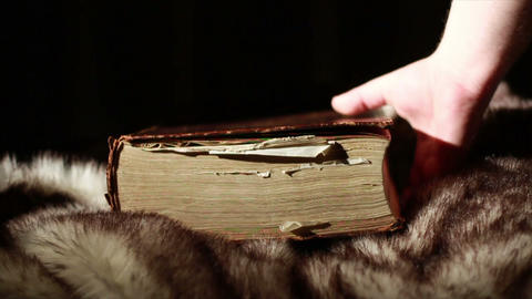 0373 Ancient Giant Book Sitting on Fur Footage