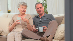 Lovely mature couple watching the tv Stock Video Footage