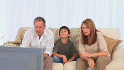 Family watching a match on tv Footage