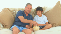 Grandfather and his grandson watching a match Footage