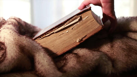 0385 Ancient Giant Book being Picked up on fur Footage