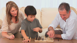 Little child playing chess Footage
