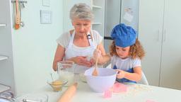 Elderly woman baking Stock Video Footage