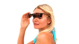Cute lady in swimsuit with sunglasses Stock Video Footage