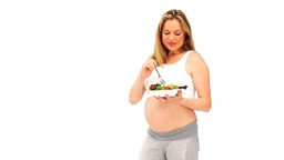 Cute pregnant woman eating a salad Stock Video Footage