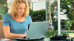 Curly haired lady working on a laptop Footage
