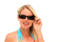 Attractive blonde woman removing her sunglasses Stock Video Footage