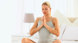 Blonde woman doing yoga position Footage