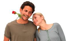 Handsome man with rose between his teeth Footage