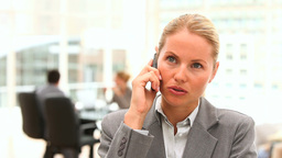 Blonde business woman speaking on the phone Stock Video Footage