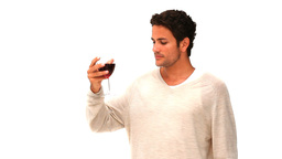 Casual man drinking a glass of red wine Footage