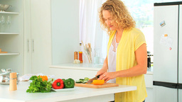Curly haired woman preparing the lunch Stock Video Footage